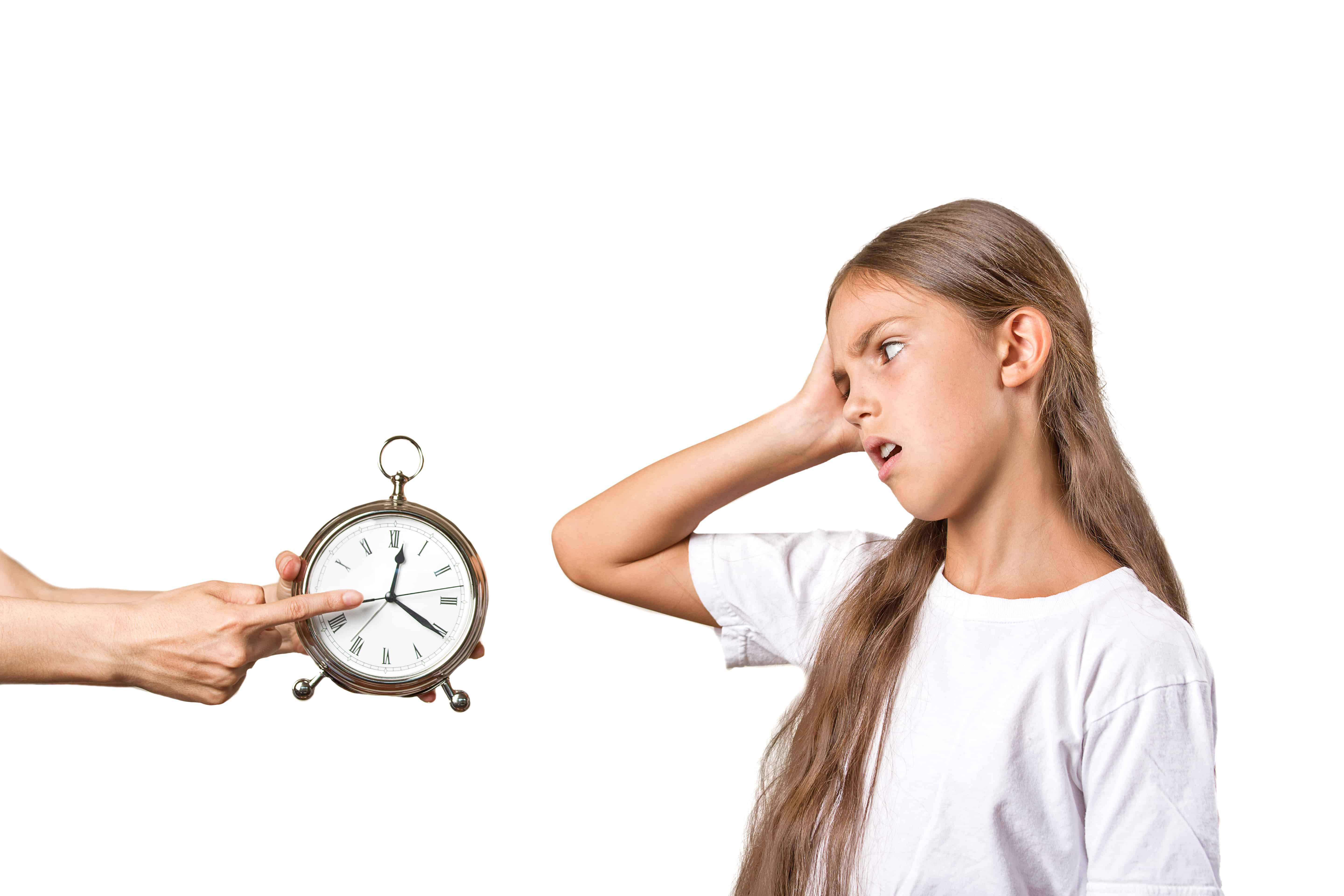 Kids time to go to bed. Portrait mom showing daughter clock that it is late. She doesn't like isolated white background. Face expression emotions. Difficult parenting concept. Children's schedule